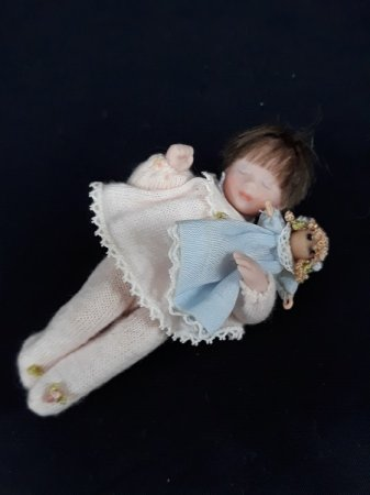 Toddler Sleeping with Doll