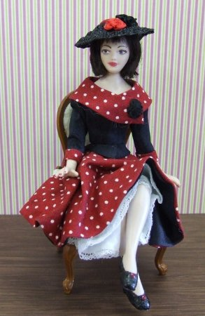 1950 Sitting Doll, Red Dress