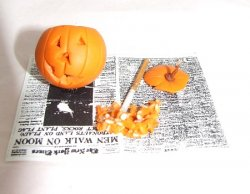 Carving Pumpkin on Newspaper
