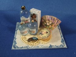 Perfume on Tray with Fan and Comb